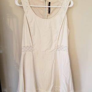 W118 Short cream color lace cutout dress